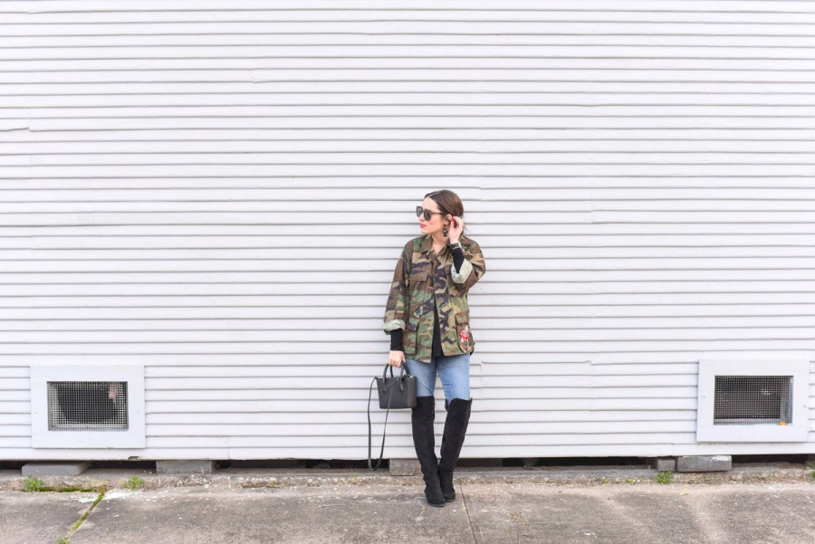 Houston fashion blogger styles an embroidered camo jacket from Planet Blue with skinny jeans, a black dagne dover tote and over the knee boots.