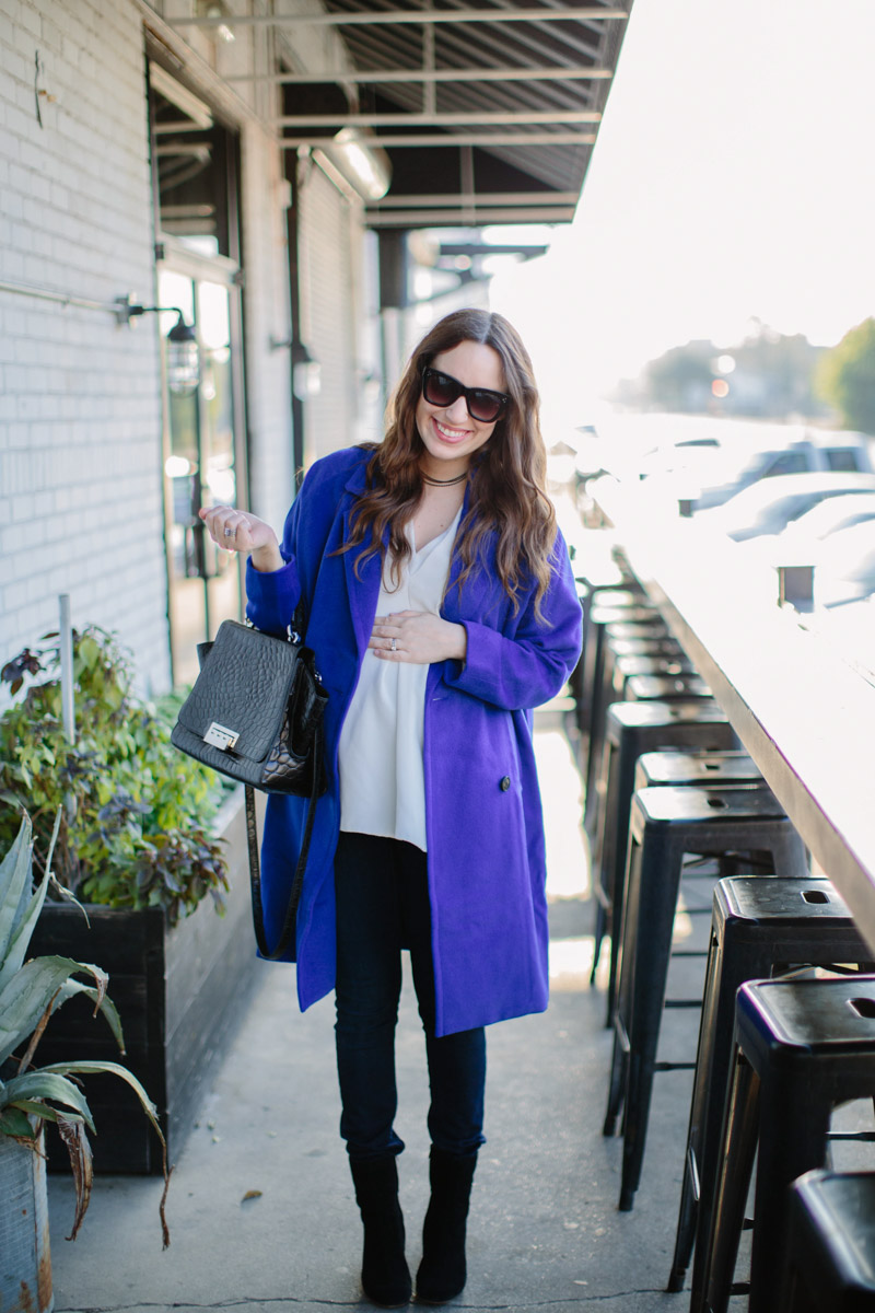 Houston fashion blogger shares winter style outfit inspiration in a JOA blue coat with a black zac posen handbag.