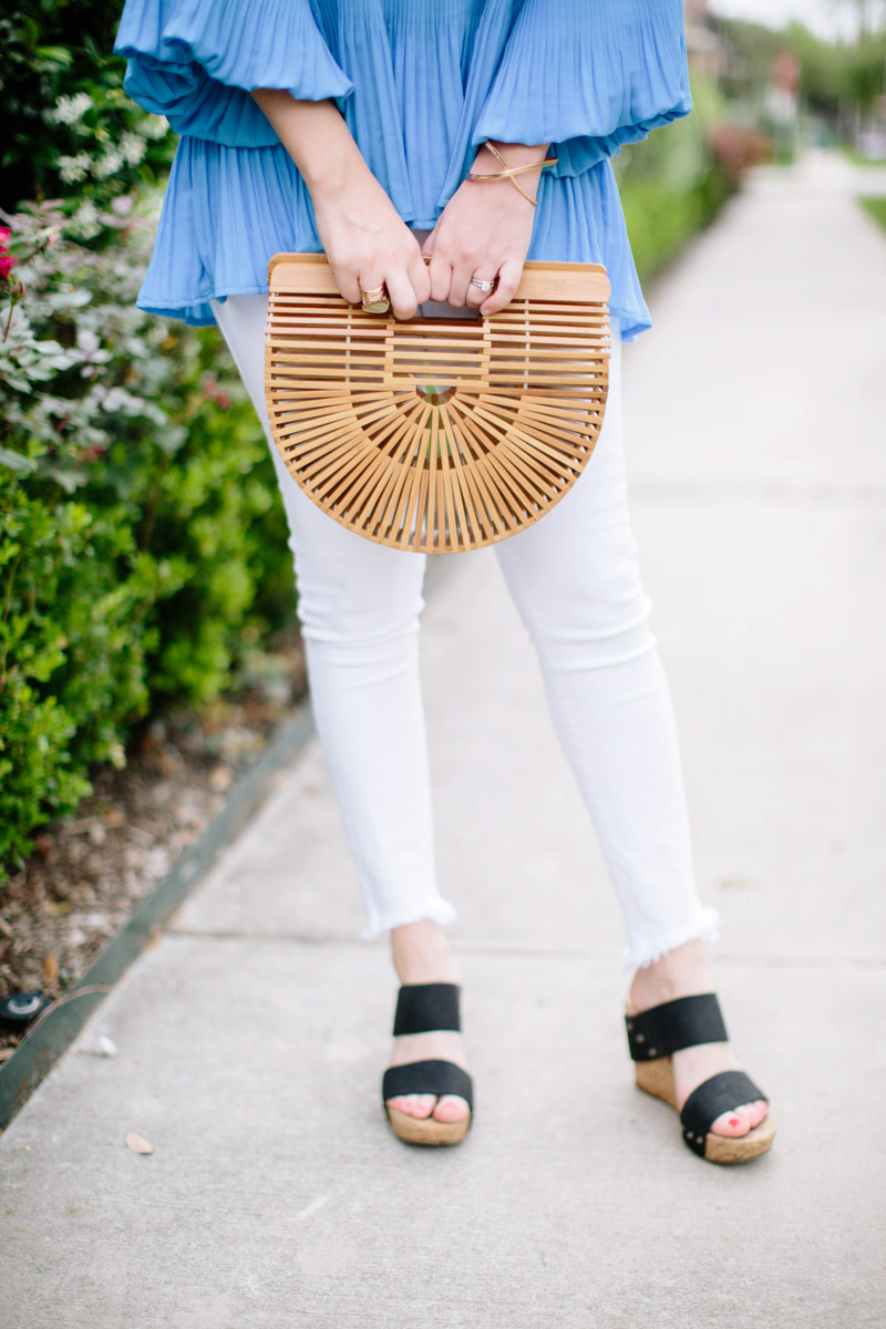 Houston blogger styles white jeans with a cult gaia bamboo bag.