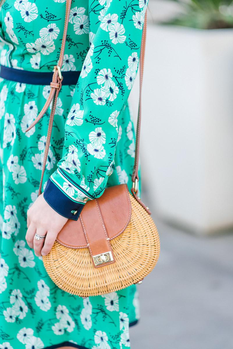 Houston blogger styles J.McLaughlin wicker crossbody bag.