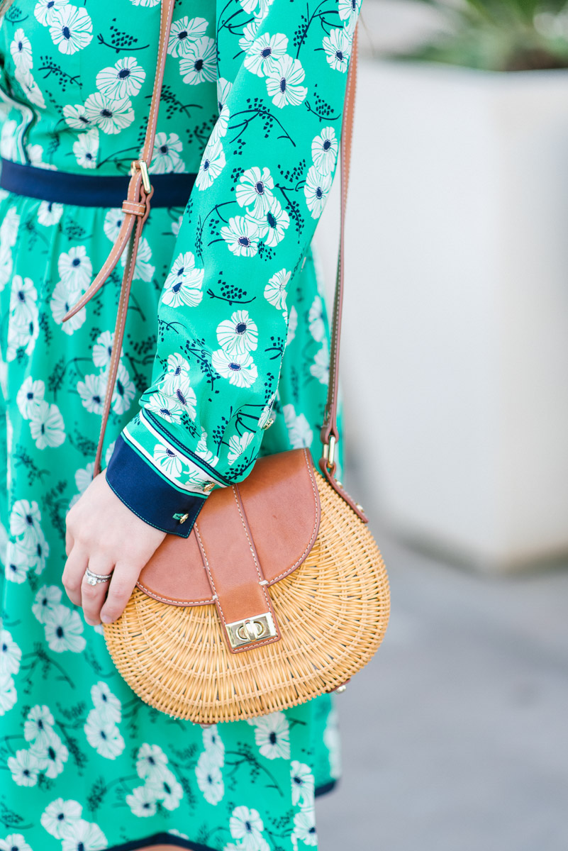 Houston blogger styles J.McLaughlin wicker crossbody bag.