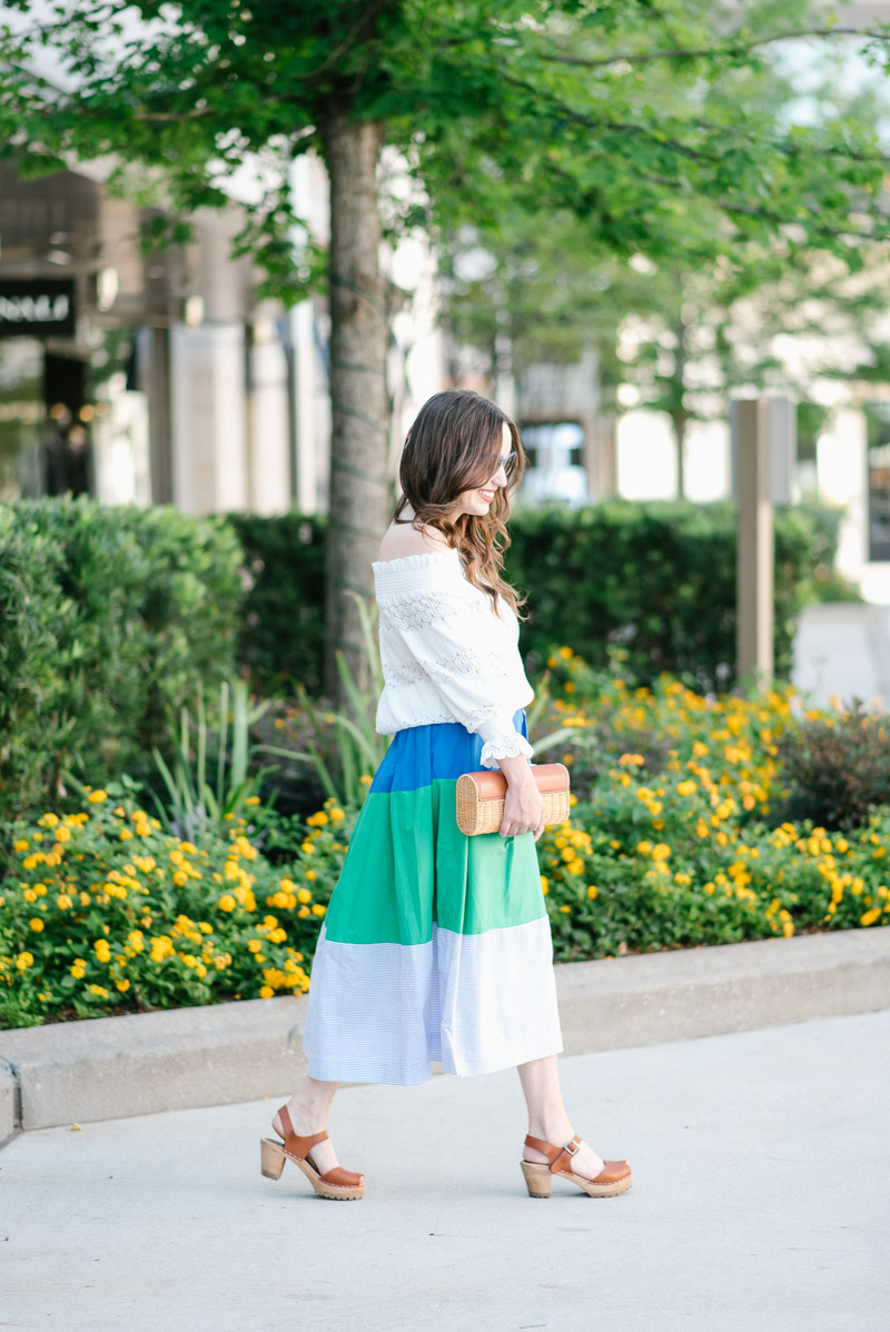 Anthropologie colorblocked midi skirt and white off the shoulder top.