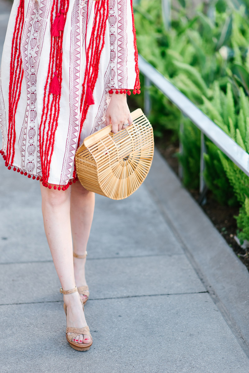 Houston fashion blogger styles Cult Gaia's bamboo bag.