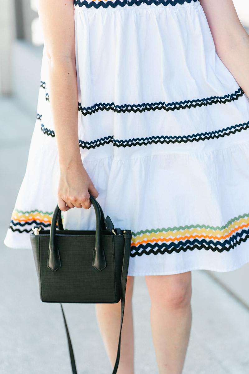 Houston fashion blogger styles a White ricrac Anthropologie Lunedi Flounced Dress