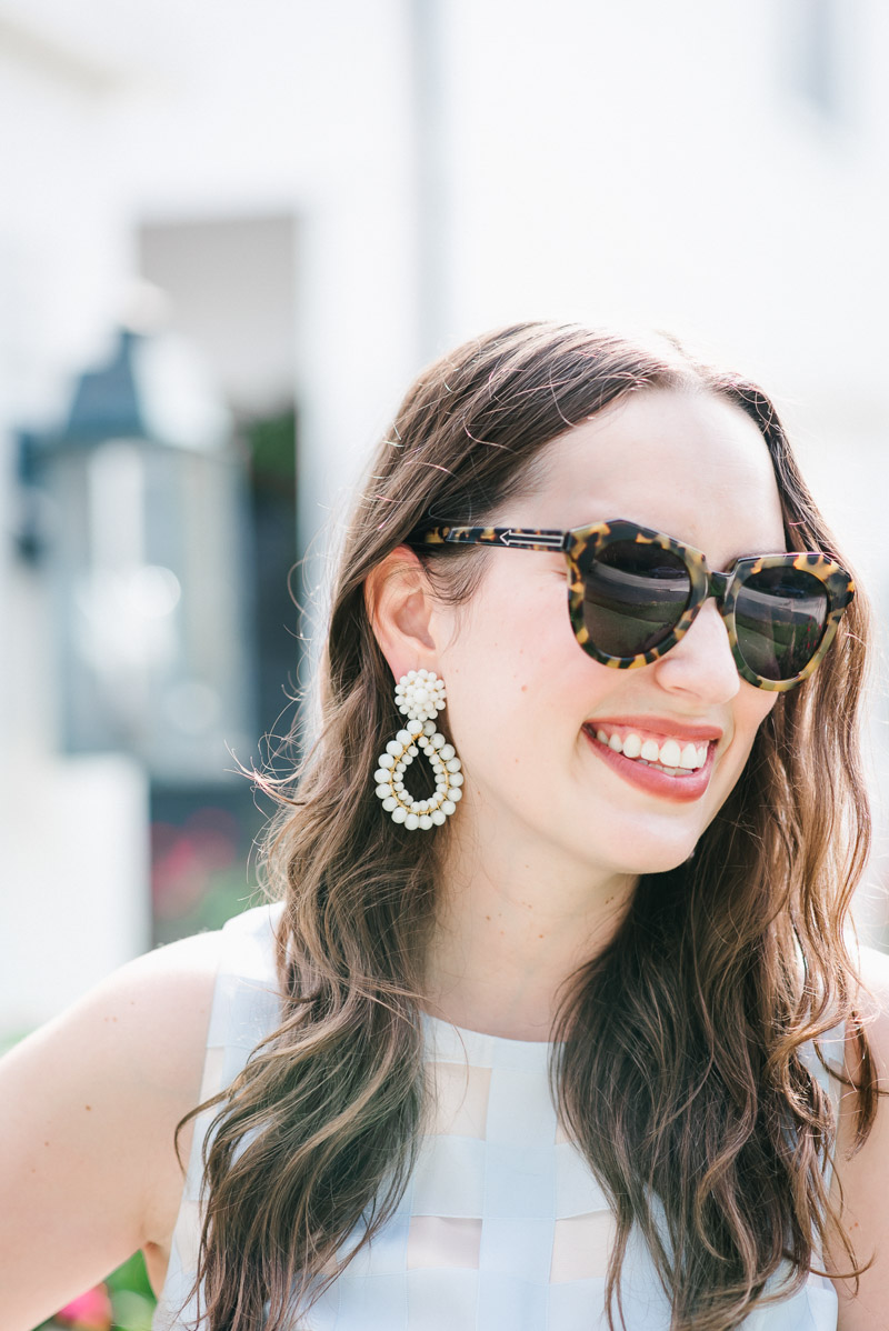 Houston fashion blogger styles white lisi lerch earrings with a blue dress for summer.