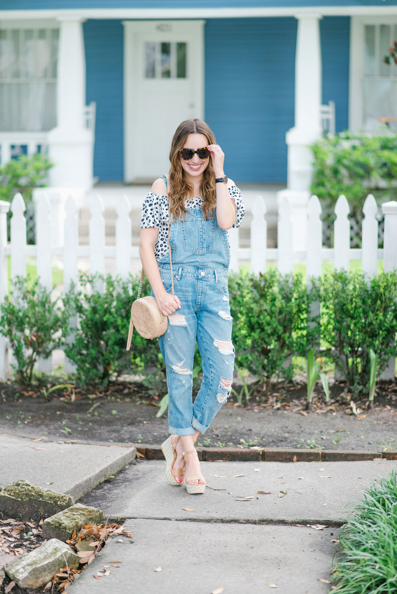 Houston fashion blogger styles overalls paired with an Anthropologie polka dot top.