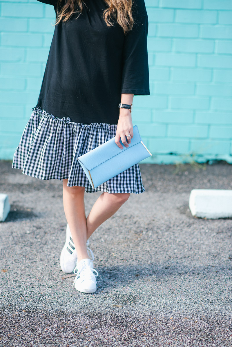 Casual and cool in a black tshirt dress with a gingham hem & addidas sneakers.