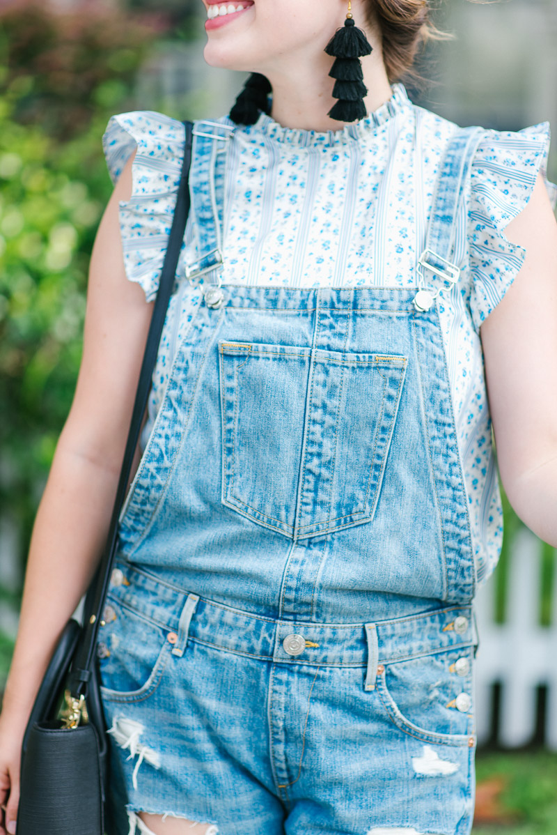 Distressed overalls with a ruffled tank for fall.