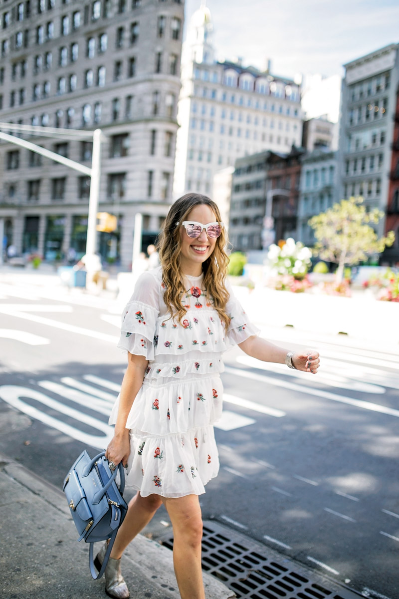 Texas blogger takes on New York Fashion Week in a Tiered Embroidered Floral Dress.