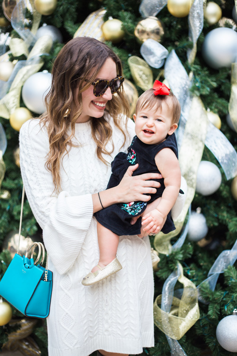 Mother Daughter Holiday Dresses - Eliza J White Sweater Dress with a black Carter's embroidered floral dress.