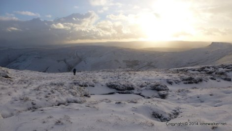 Sun setting ahead as we circle around Pym Chair and head for a possible camp on the western edge of Kinder