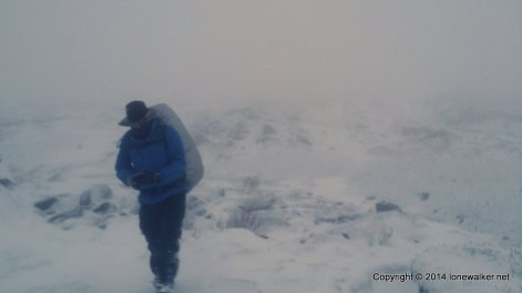 The wind and snow make the descent tricky as the path is slick and icy in places