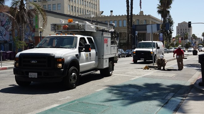 SCE power outage downtown long beach crew working on manhole