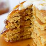 Cinnamon caramel butter syrup poured on pumpkin pancakes