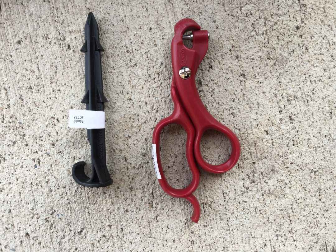 Tubing stake and hole punch