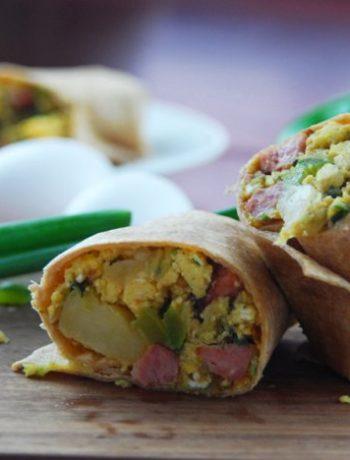 Front view of halved breakfast burritos.