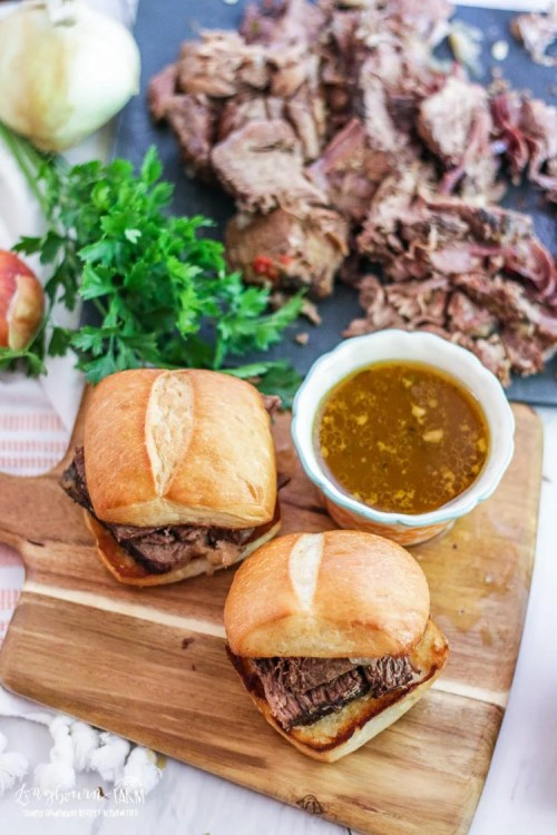 This slow cooker Italian beef sandwich recipe is a family favorite and a crowd pleaser every time. Get an easy start on dinner today and use the leftovers all week long! #longbournfarm #homemademeal #homeamdedinner #cookingfromscratch #scratchcooking #homecooked #homecookedmeal #homecookeddinner #simplefood #homegrownfood #fromscratch #roastbeef #italianroastbeef #roastbeefsandwich #italianbeefsandwich #italianbeef #beefsandwich #slowcooker #crockpot #slowcookermeal #crockpotmeal