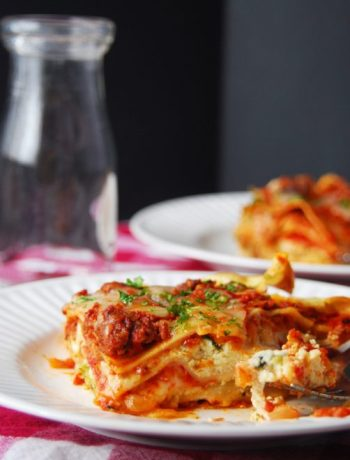 Slice of homemade lasagna on a plate.