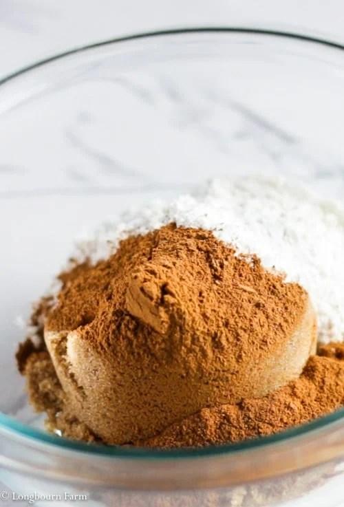 Streusel ingredients (brown sugar, cinnamon, flour) in a small glass bowl.