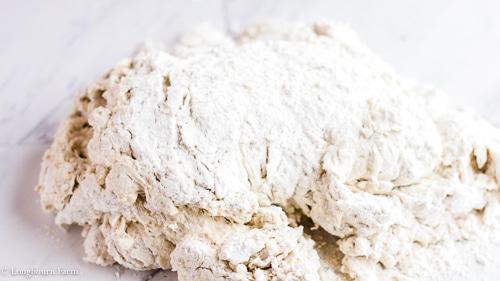 Shaggy dough, waiting to be kneaded for homemade focaccia dough.