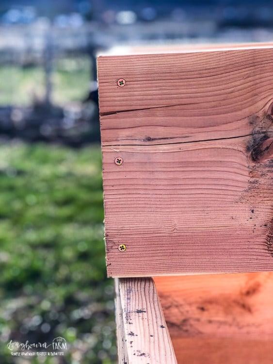 Three screws securing corner for raised planter garden beds.