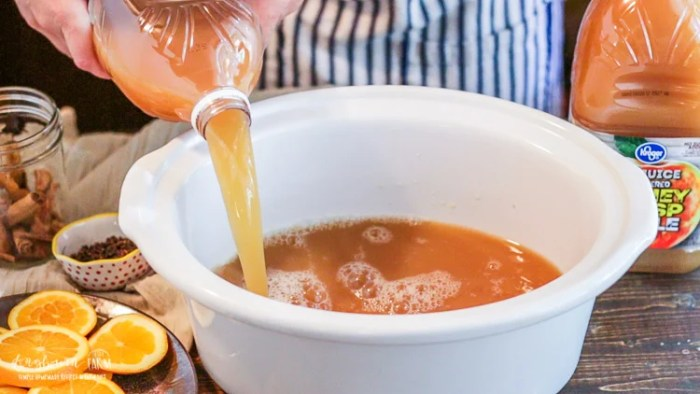 Fresh apple juice being used for mulled apple cider.