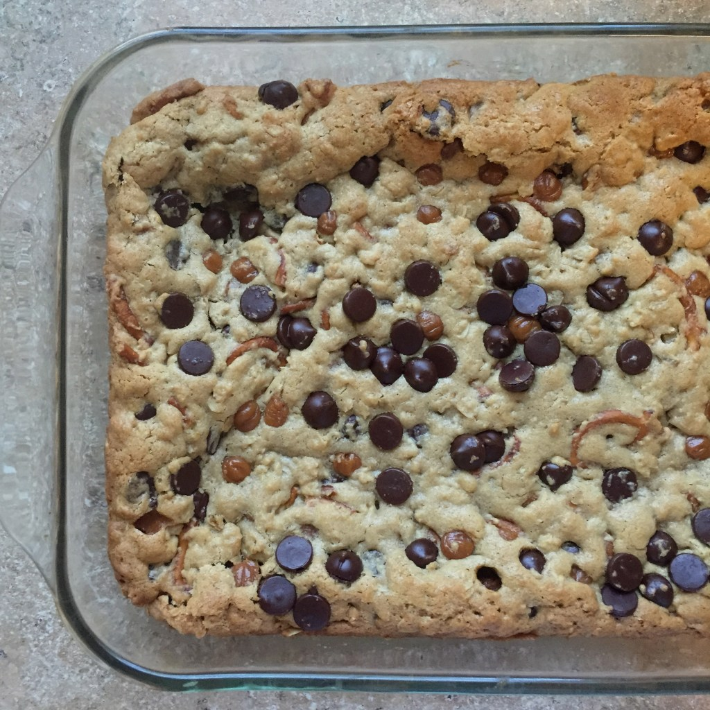 Everything Cookie Bars - chocolate chips, caramel, pretzels and peanut butter! | longdistancebaking.com