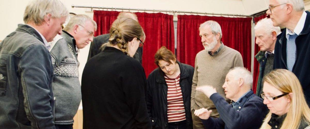 Parish councillors gathered around a desk