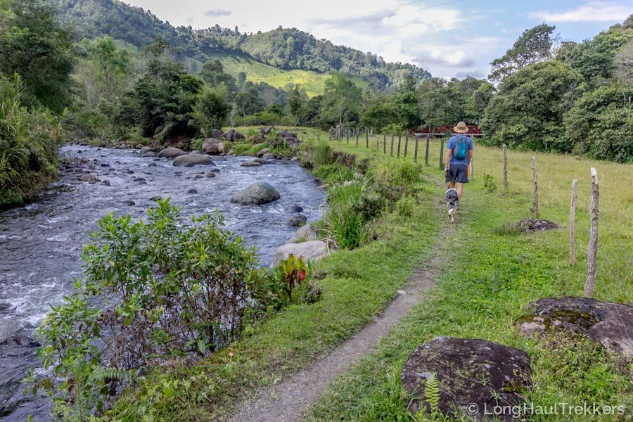 Dave and Sora walking along a local river trek in Salento Colombia | Long Haul Trekkers