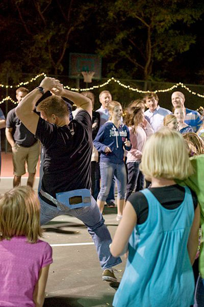 Fun Wedding Ideas man dancing with kleenex box of ping pong balls taped to his hips