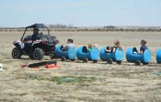 tractor train pulling kids around the longmeadow field
