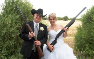 newly married couple holding shot guns at longmeadfow event center