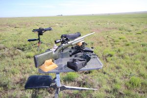 shooting benches and a hunting rifle in a field