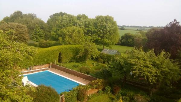 The swimming pool, viewed from the cinema room in our luxurious English country house sit