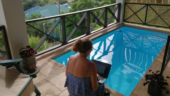 Vanessa at work by our balcony plunge pool