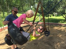 son and daughter on the tire swing