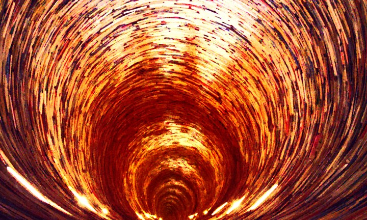 A glowing, scaly tunnel in reds, golds, oranges and browns