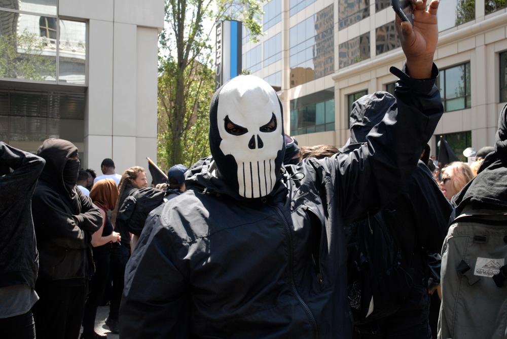 skullmasked protestor