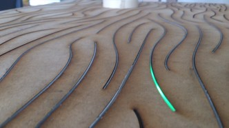 Polypropylene inserted into laser cut MDF with battery powered LED's testing the transparency