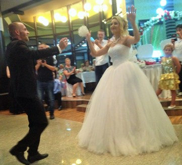 The bride and groom start their dance.