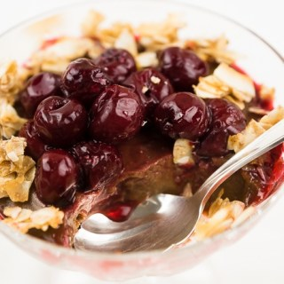 Creamy Coconut Chocolate Pudding with Sour Cherries and Coconut Brittle