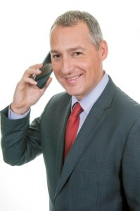Mature Male Businessman smiling on phone