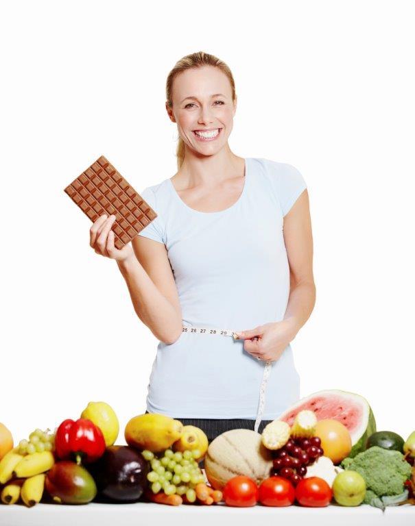 Woman with chocolate & veggies