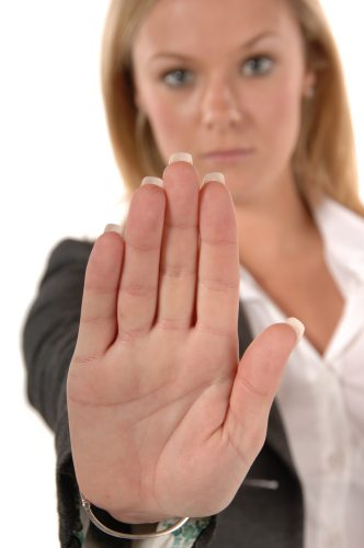 Close-up of woman's hand signaling stop