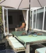 Outdoor dining area with parasol