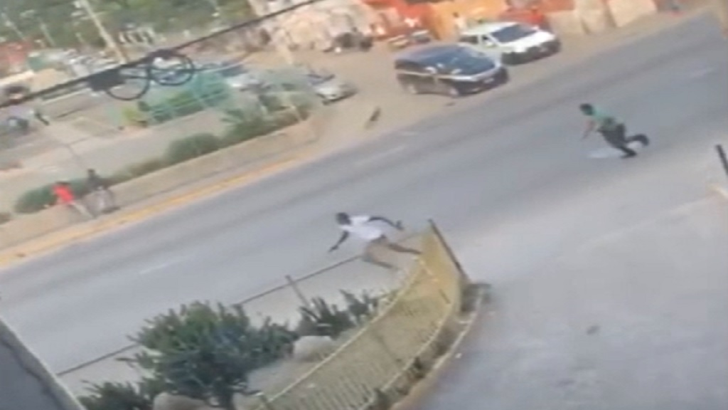 A screen grab from a video recording of the shooting scene on Constant Spring Road in Half-Way Tree, St Andrew on Friday afternoon.