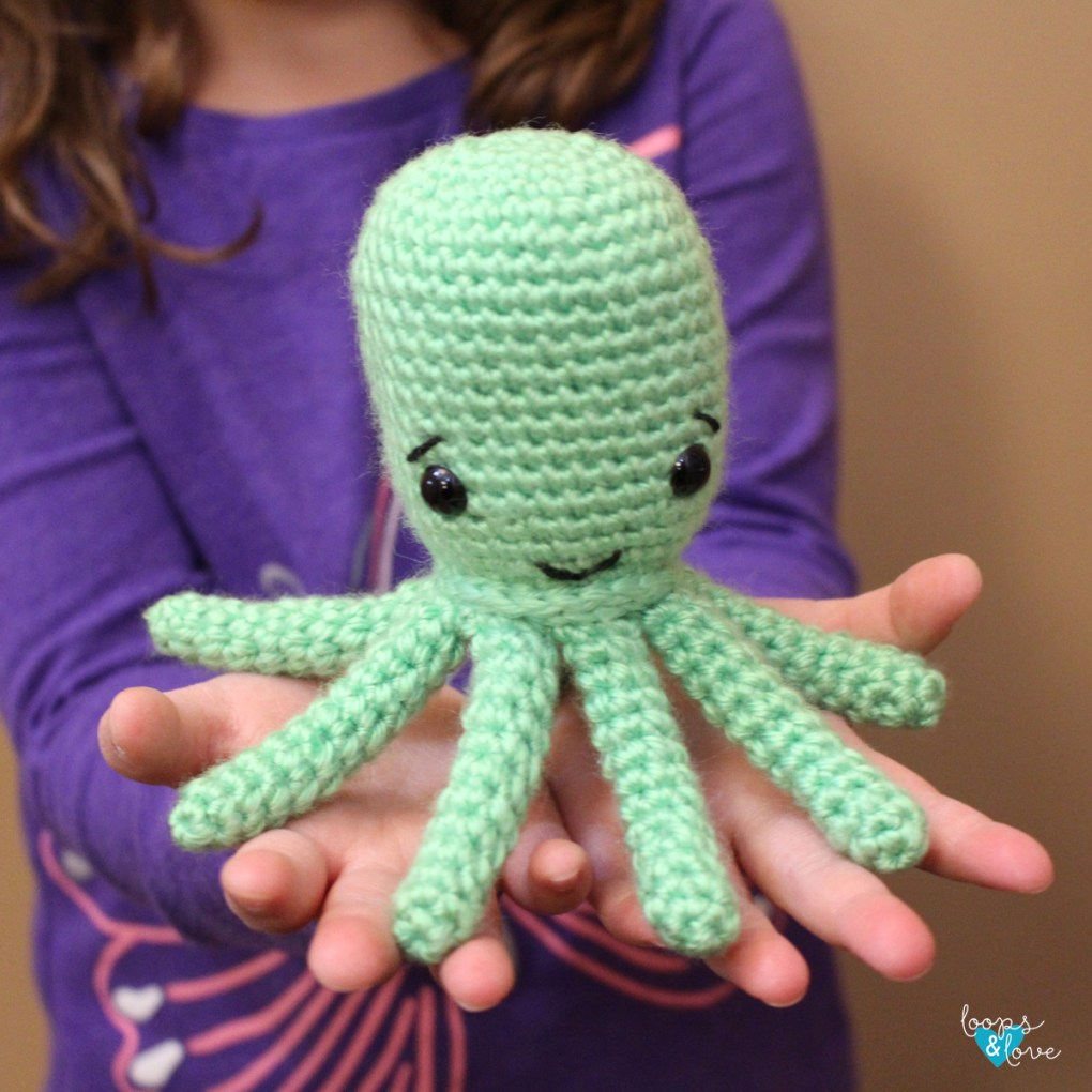 Crochet Octopus Amigurumi sitting on open hands