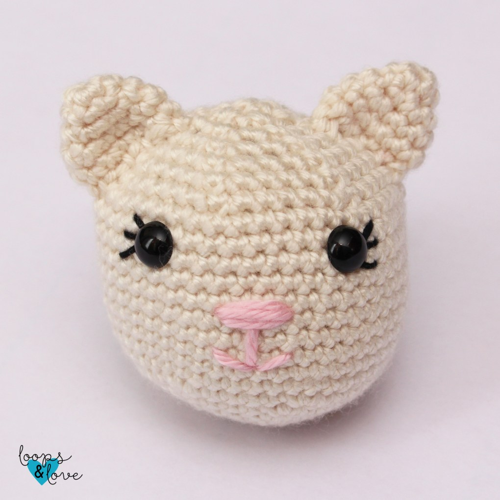 kitty lovey head with eyes, nose, mouth, and ears attached