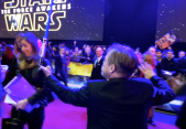 Mark Hamill doing tricks with a lightsaber