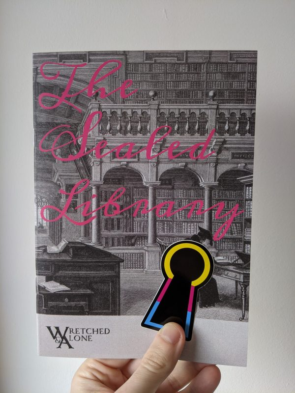 """A hand holding a book illustrated with an old library. Pink cursive text on the cover reads """"The Sealed Library"""". A keyhole-shaped sticker with a border of yellow, magenta, and cyan is held against the cover of the book."""